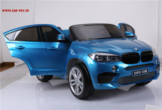 China Licensed Bmw X6 Kids Electric Car With 2 Seats Plastic Blue