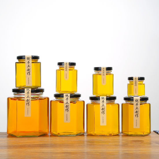 Hexagonal Glass Honey Jar Lead-Free Glass Bottle with Metal Lid pictures & photos