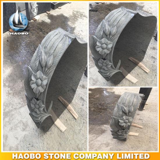 Black Granite Headstone with Carved Flowers