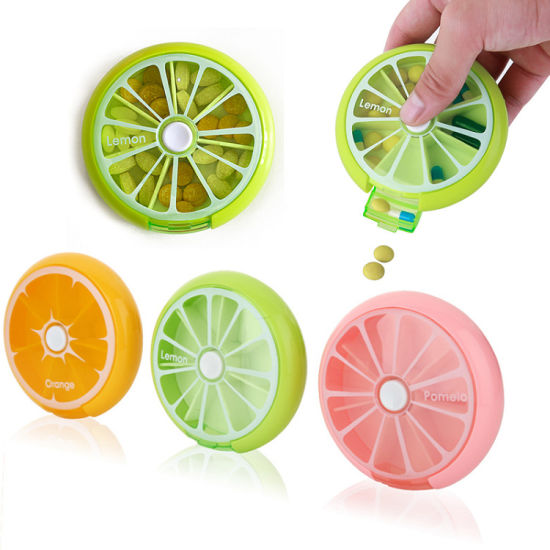 Outdoor Portable Large Capacity 7 Day Weekly Round Rotating Fruit Push Button Plastic Pill Vitamin Medicine Box pictures & photos