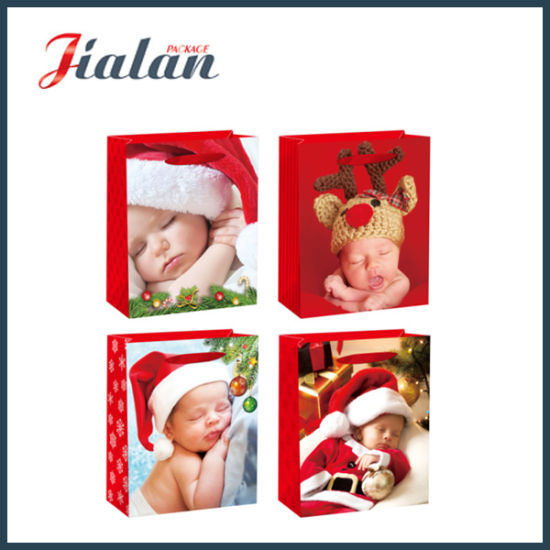 Wholesale Sleeping Baby Design Printed Christmas Shopping Gift Paper Bag pictures & photos