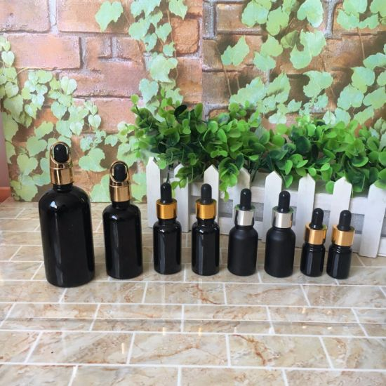 Hot Sell 30ml 50ml 100ml Black Coating Empty Glass Essential Oil Dropper Bottle with Pump pictures & photos