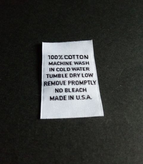 White Background Black Text for Clothing Woven Label pictures & photos
