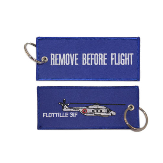 China Wholesale New Embroidery Remove Before Flight Keychain