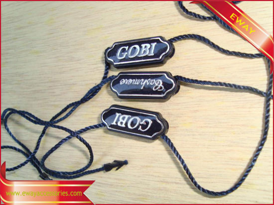 Plastic Seal Tag Garment String Tag Silver Logo Plastic Tag pictures & photos