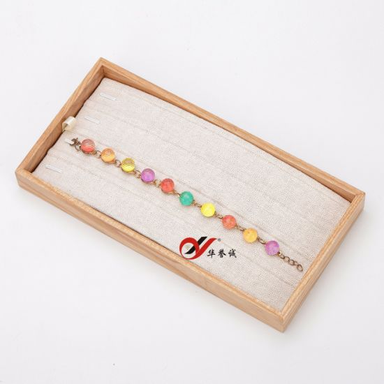 Hot Sell on Hong Kong Exhibition Yellow Linen Material Chain Display pictures & photos