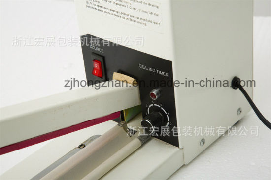 Aluminum Body Heat Hand Sealer Impulse Sealing Machine with Cutter pictures & photos