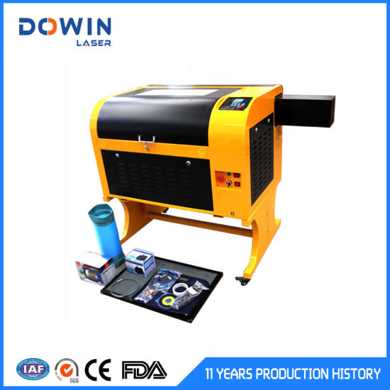 CO2 50W 60W 80W Laser Engraving Cutting Machine for Paper Crystal Glass Leather Rubber pictures & photos