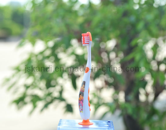 Cartoon Design with Tongue Clean Kid Toothbrush Supplier (3-10 years) pictures & photos