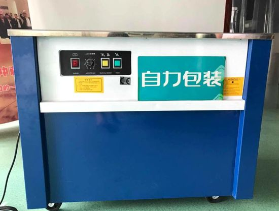 Semi Automatic Packing Machine PP Strapping Machine for Carton/Box pictures & photos
