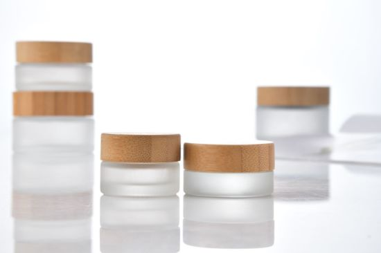 Hot Sale Cosmetic Face Cream Container 20ml 30ml 50ml 100ml Frosted Clear Glass Jar with Bamboo Wood Lid Packaging for Skin Care