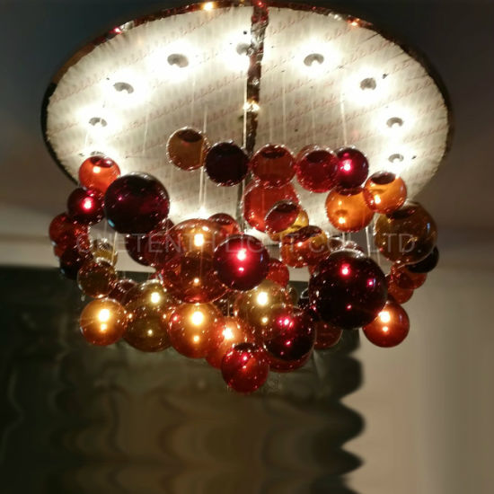 Round Metal Canopy Incandescent Glass Ball Chandelier at Bar