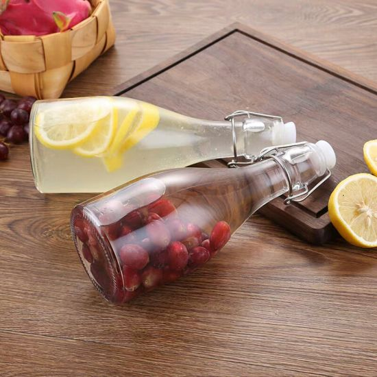 Hot Selling Transparent Glass Juice Bottles with Sealed Clasps pictures & photos