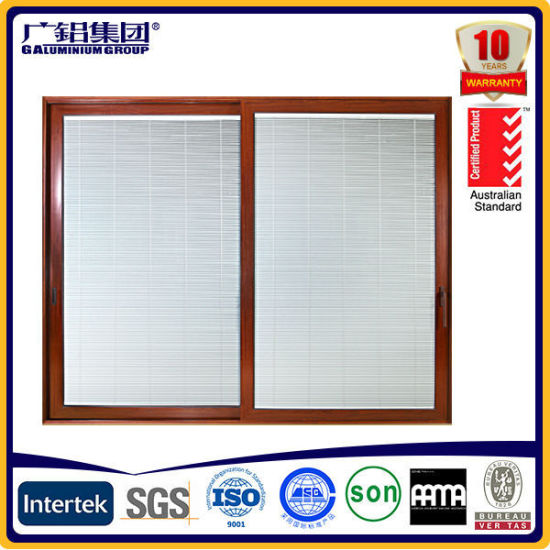 Double Glass Aluminium Wood Sliding Doors with Built in Blades pictures & photos