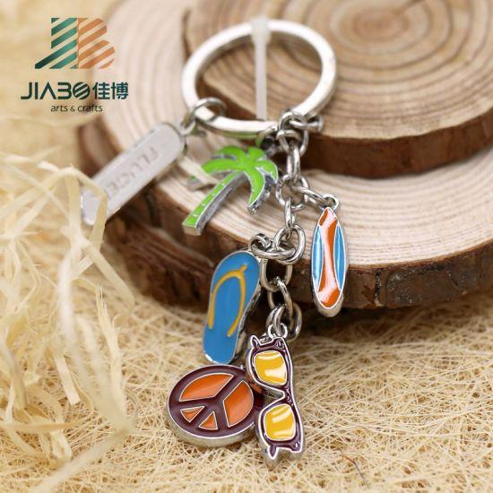 China Customize Soft Enamel Ubs Logo Round Metal Key Chain