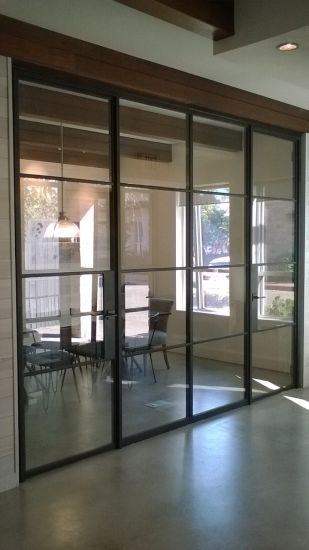 China Hand Made Metal Steel French Bifold Door With Dual Panel Glass