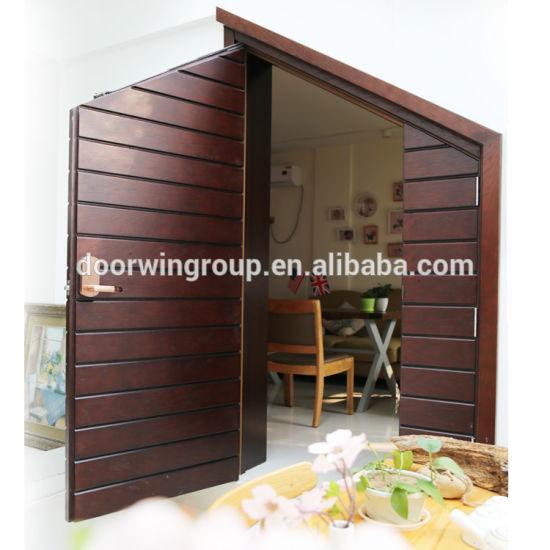 Double swinging wood door