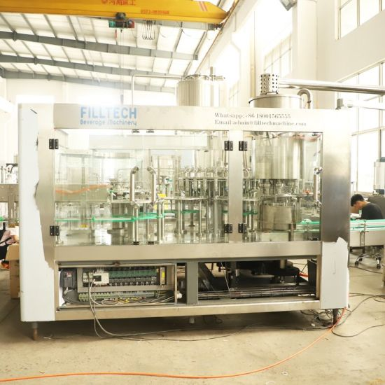 Rotary Type Plastic Bottled Juice Filling Machine for Medium Capacity pictures & photos