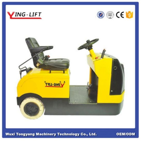 Electric Stand-on Tow Tractor with 3000kg Towing Capacity pictures & photos