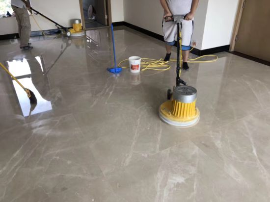 people restoring marble flooring