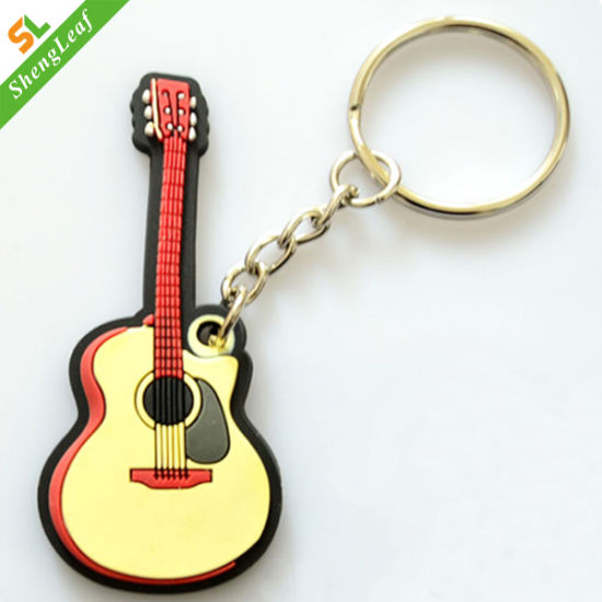 Music Tool Both Side Design Rubber Guitar Keychain pictures & photos