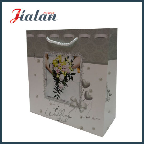 210g White Card Custom Printed Logo Paper Wedding Shopping Bag pictures & photos