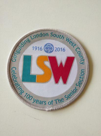 Backing and Overlocking Border Clothing Woven Badge