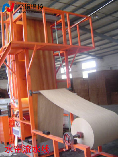 High Quality and Lower Price Evaporative Cooling Pad Production Line pictures & photos