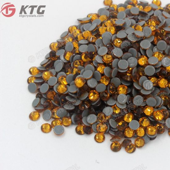 High Quality 12 Facets Copy Austrian Mc Stone Topaz Crystal Flatback Rhinestones pictures & photos