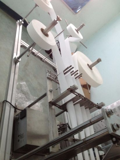 Four Side Sealing Wet Tissue Folding and Packing Machine pictures & photos