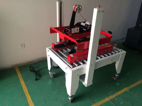 Right and Left Driven Type Semi Automatic Carton/Case Sealers pictures & photos