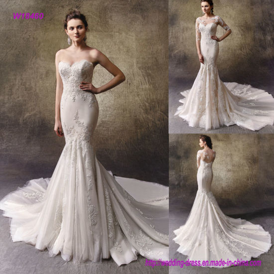 82aac4fdda0c Two Lovely Looks in One Full-Length Mermaid Wedding Dress with an Outer  Dress of Embroidered Lace and Tulle Features a Soft Strapless Sweetheart  Neckline