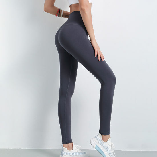 woman in running leggings nude
