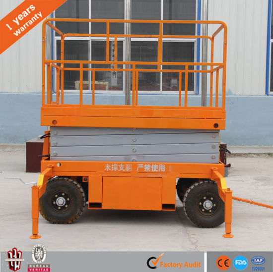 China Manufacturer 12m Height Trailer Mobile Scissor Lift with Ce pictures & photos