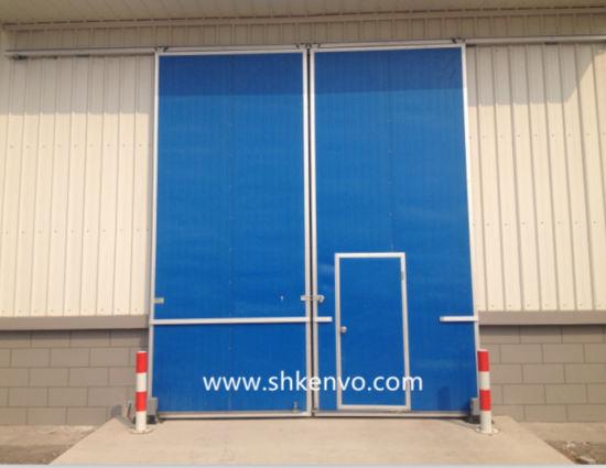 Industrial Sliding Door With Small Man Door