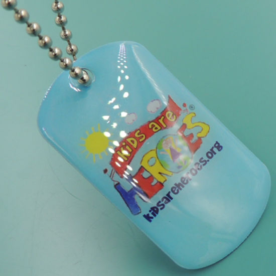 Hotsale Cheaper Printing Laser Dog Tags with Rubber Siliencer (XDNT-01) pictures & photos