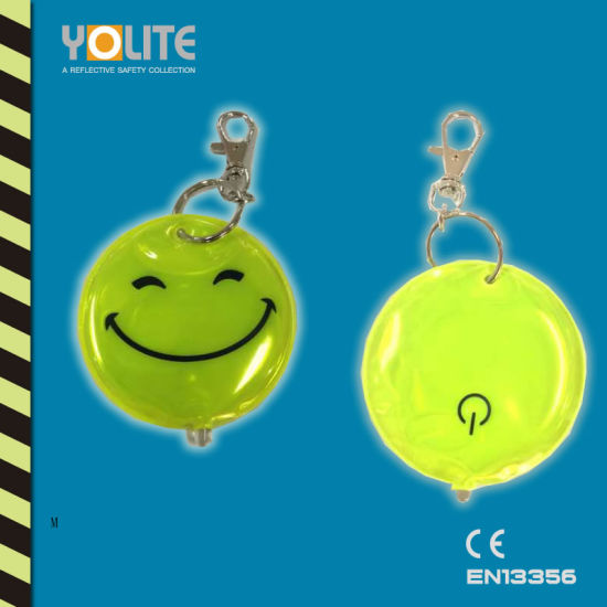 Wholesale LED Reflective Soft Keychain with Smile Face for Safety pictures & photos
