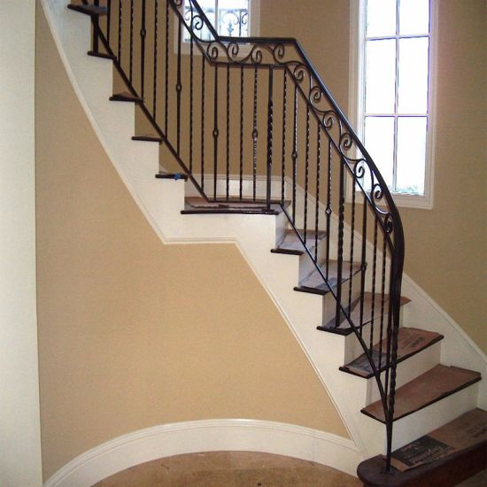 Wood Curved Staircases with Wrought-Iron Balusters