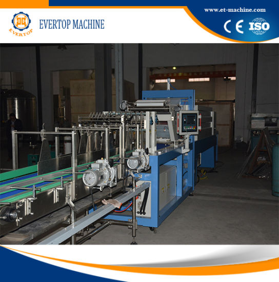 Auto PE Film Shrink Packing Machine pictures & photos