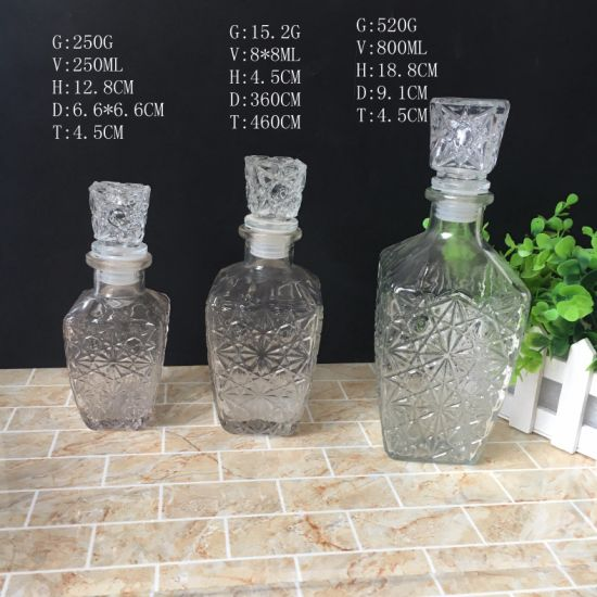 FDA 250ml 500ml 800ml Engraved Glass Red Wine Vodka Liquor Bottle with Glass Stopper pictures & photos