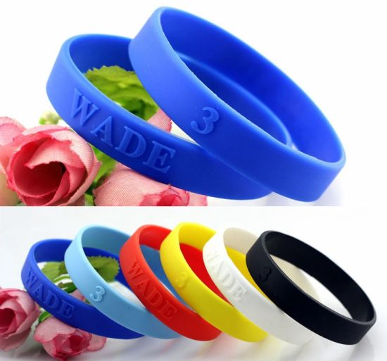 Promotional Give Away Logo Embossed Engraved Silicone Adult Wristbands pictures & photos