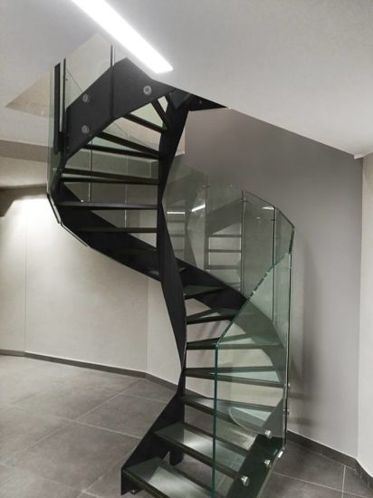 Modern Spiral Staircase With Glass Tread And Steel Railing
