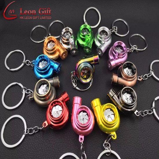 Factory Wholesale Metal Colorful Fashion Nos Bottle Key Chain pictures & photos