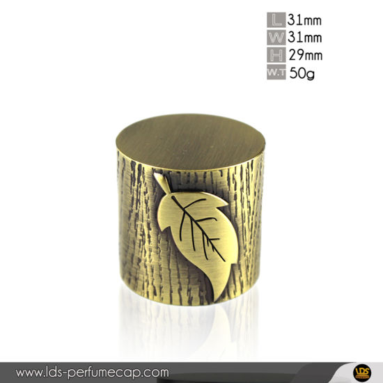 OEM Shiny Bronze Color Metal Zamac Perfume Cap with Wooden Leaf Effect