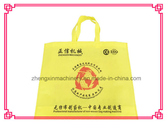 Non Woven Handle Bag Making Machine Price (Zxl-D700) pictures & photos