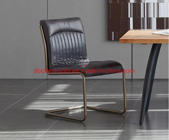 Usine directement Haut de la conception de luxe en cuir de vache du grain de l'accent chaises de salle à manger avec Golden jambes