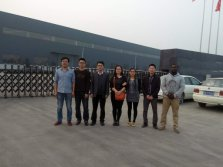 Sales Team at the Gate of Factory