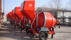 Mobile diesel concrete mixer with self loading system