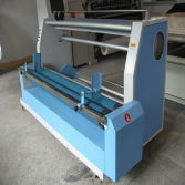Automatic edge aligning fabric rolling machine