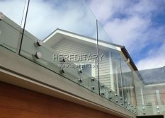 Glass standoff project in frameless glass railing